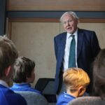 Sir David Attenborough talking to students